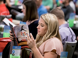 A Person Reading at World Workplace 2019